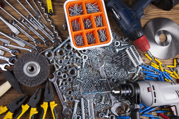 Assorted work tools on wood background Stock photo © JanPietruszka