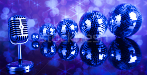 Stock photo: Retro style microphone on sound waves and Disco Balls