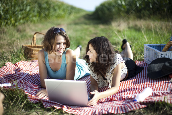 Stock photo: Girls on picnic, summer free time spending