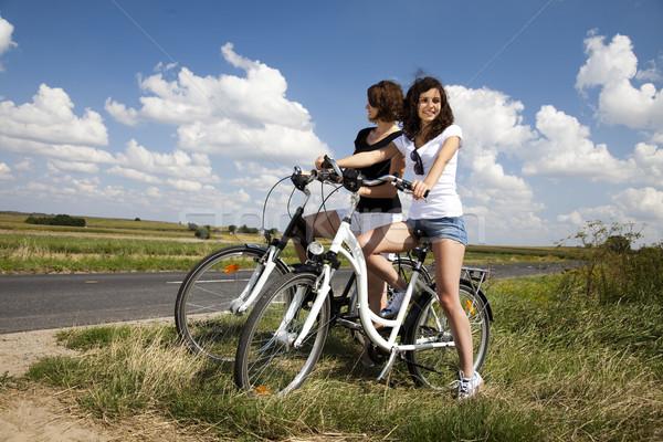 Young woman riding bike, summer free time spending Stock photo © JanPietruszka