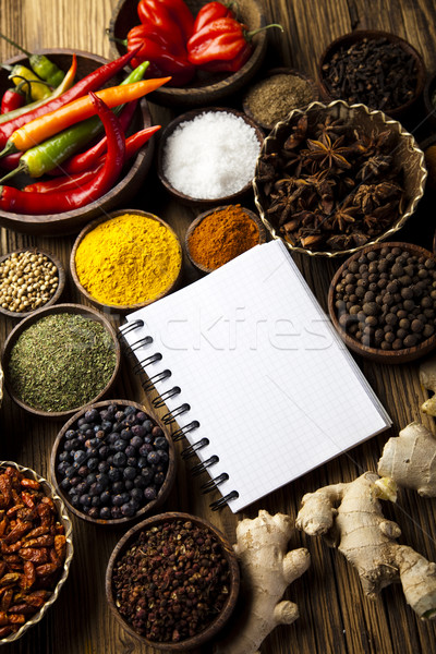 Stock photo: Cookbook and various spices, orintal cuisine vivid theme
