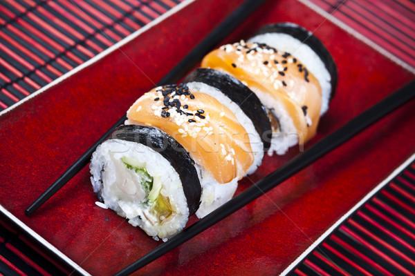 Sushi cucina orientale colorato pesce tavola bambù Foto d'archivio © JanPietruszka