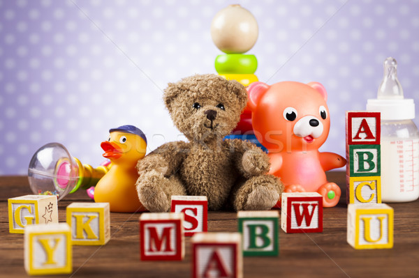 Stock photo: Children's of toy accessories on wooden background