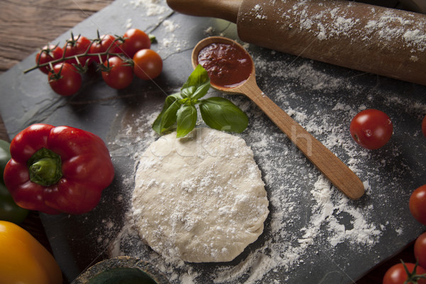 Fresh an tasty homemade pizza preparation Stock photo © JanPietruszka