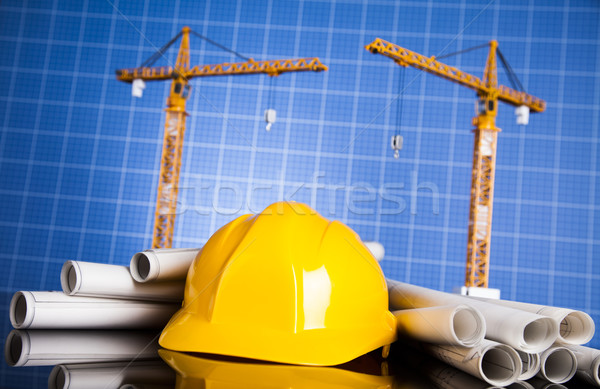 Crane, Safety helmet, Blueprints and construction site Stock photo © JanPietruszka