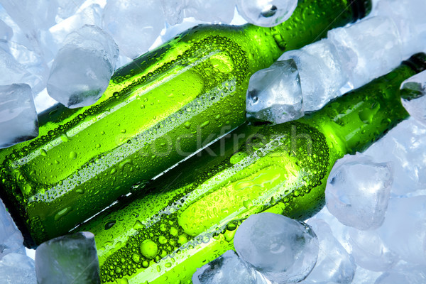 Beer is in ice, bright vibrant alcohol theme Stock photo © JanPietruszka