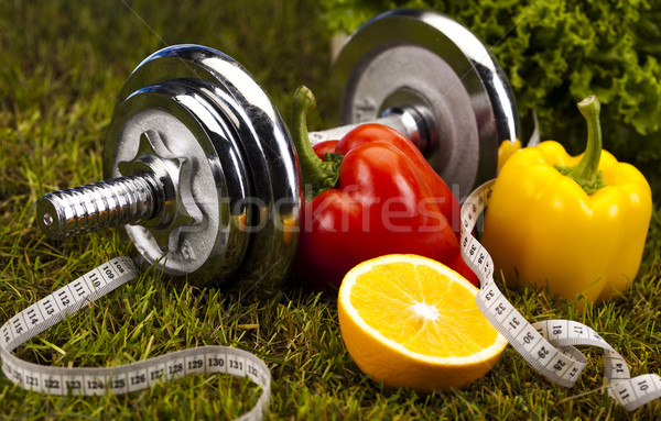 Vitamin and Fitness diet, dumbell in green grass Stock photo © JanPietruszka