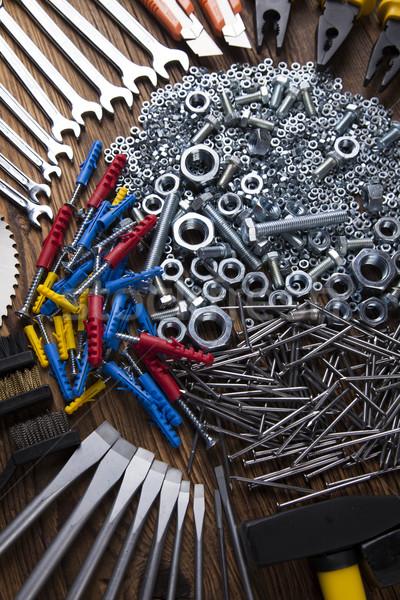 Assorted work tools on wood background Stock photo © JanPietruszka