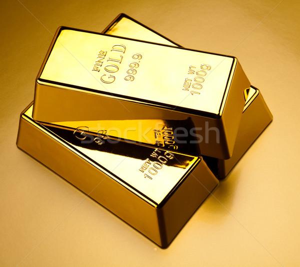 Boglya aranyrúd pénzügyi pénz fém bank Stock fotó © JanPietruszka