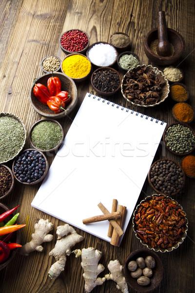 Wooden bowl spice, orintal cuisine vivid theme Stock photo © JanPietruszka