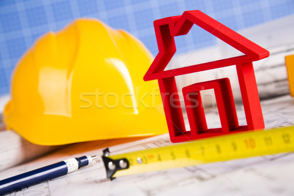 Stock photo: Architectural project and Yellow helmet and house model