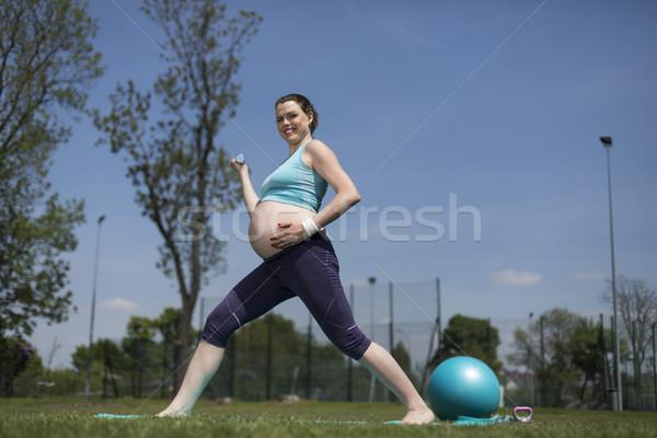 Pregnant woman with fitness Stock photo © JanPietruszka
