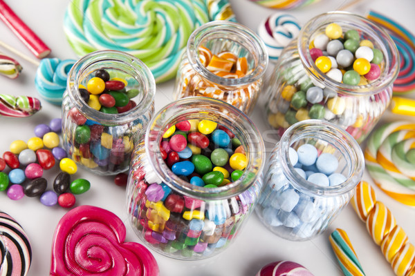 Colorful lollipops and different colored round candy and gum bal Stock photo © JanPietruszka