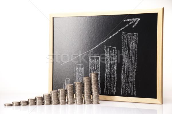 Stock photo: Rising coin chart