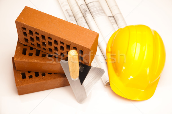 Hard hat with bricks and trowel Stock photo © JanPietruszka