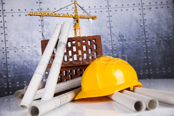 Crane, Safety helmet, Blueprints and construction site Stock photo © JanPietruszka