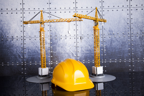 Construction plan with a crane and yellow helmet Stock photo © JanPietruszka