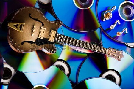 Discs and guitar, bright colorful vivid theme Stock photo © JanPietruszka