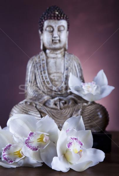 Buddha statue with orchid flower Stock photo © JanPietruszka