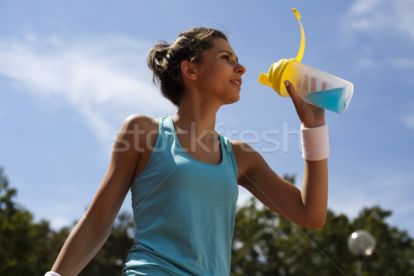 Young woman playing tennis Stock photo © JanPietruszka