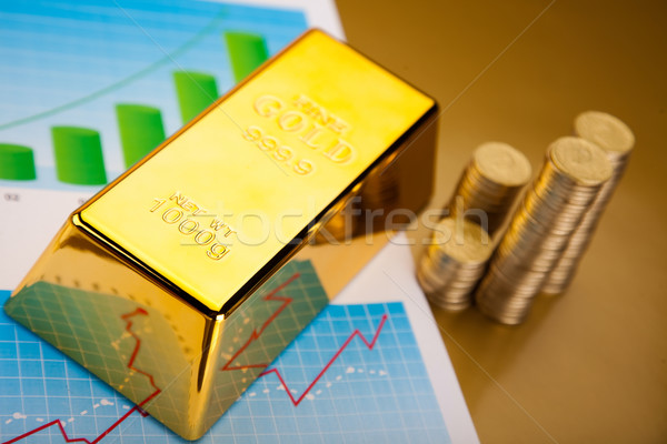 Gold bars with a linear graph, ambient financial concept Stock photo © JanPietruszka