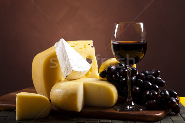Cheese and red wine, saturated ambient rural theme Stock photo © JanPietruszka