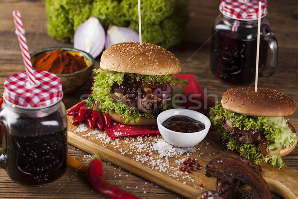 Close-up of home made burgers, wooden desk background Stock photo © JanPietruszka