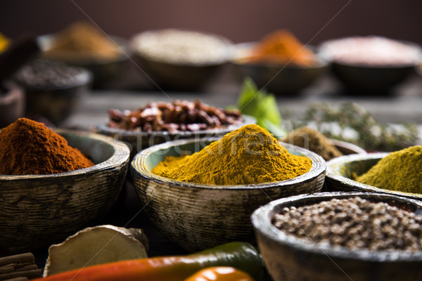 Spices and herbs and Wooden bowl Stock photo © JanPietruszka