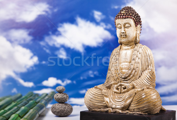 Buddha and blue sky background  Stock photo © JanPietruszka