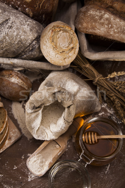 Freshly baked traditional bread on wooden table Stock photo © JanPietruszka