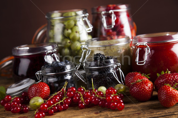 Stock photo: Glass of mixed berry jam with strawberries, bilberries, red curr
