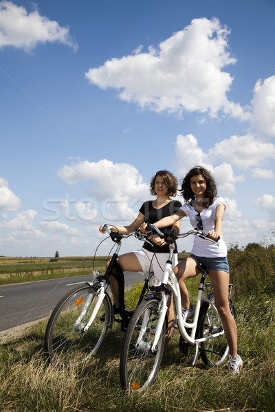 Woman riding bicycle, summer free time spending Stock photo © JanPietruszka