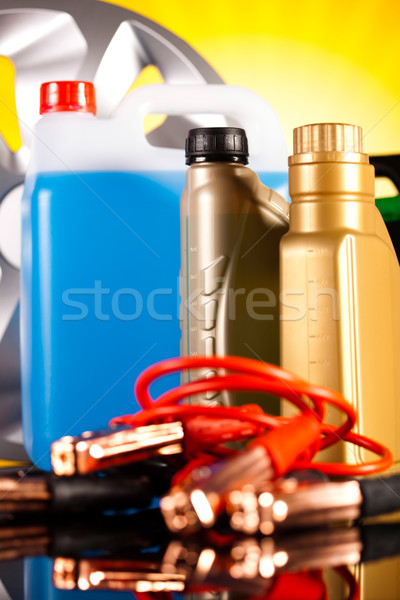 Stock photo: Set of auto parts, car battery on vivid moto concept