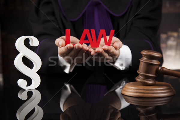Paragraph, Judge hold hammer on wooden table Stock photo © JanPietruszka