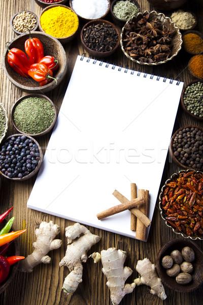 Cookbook and various spices, orintal cuisine vivid theme Stock photo © JanPietruszka