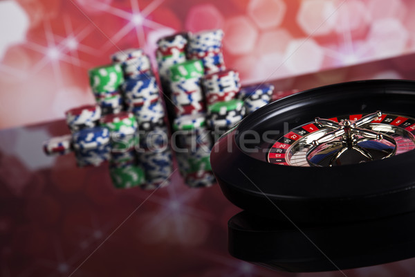 Poker Chips on a gaming with casino roulette Stock photo © JanPietruszka