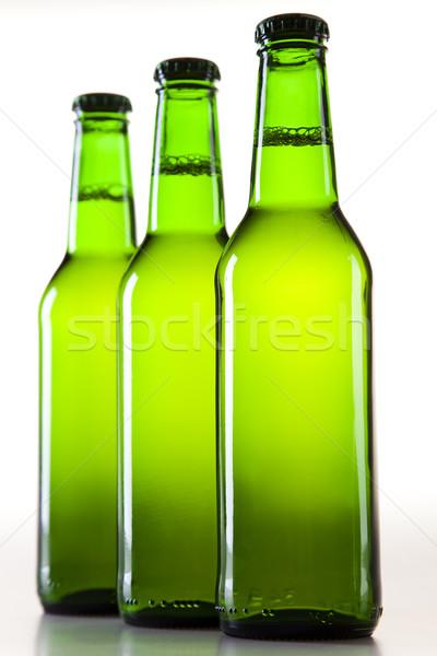 Stock photo:  Green bottle of beer