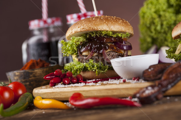 Home made burgers on wooden background Stock photo © JanPietruszka