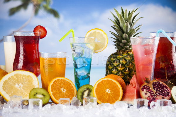 Summer drink, palm branch and Fresh tropical fruits Stock photo © JanPietruszka