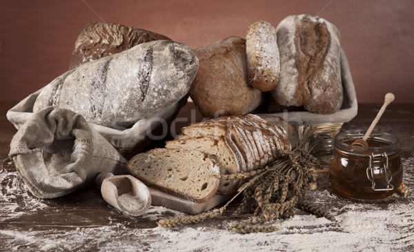 Fresh bread and wheat on the wooden Stock photo © JanPietruszka