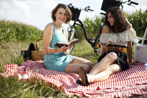 Girls on picnic, summer free time spending Stock photo © JanPietruszka