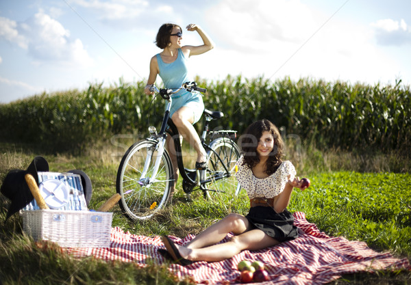 Stock photo: Girls on picnic, summer free time spending