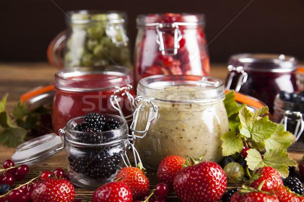 Jams in glass jars with wood and fresh berries  Stock photo © JanPietruszka