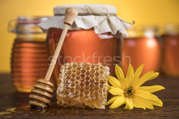 Jar płynnych miodu słodkie grzebień szkła Zdjęcia stock © JanPietruszka