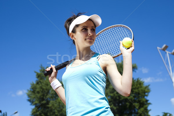 Stock photo: Young woman playing tennis, natural colorful tone