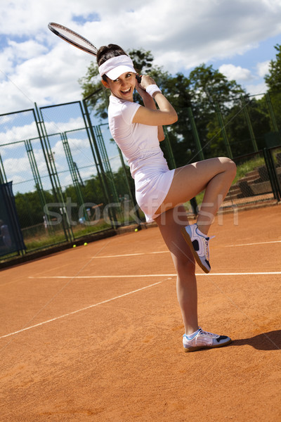 Stock photo: Woman playing tennis, natural colorful tone