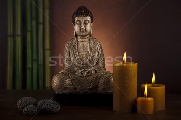 Buddha with candle Stock photo © JanPietruszka