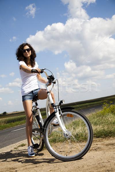 Woman riding bicycle, summer free time spending Stock photo © JanPietruszka