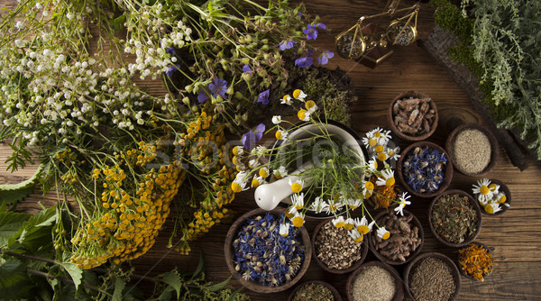 Natural medicine on wooden table background Stock photo © JanPietruszka