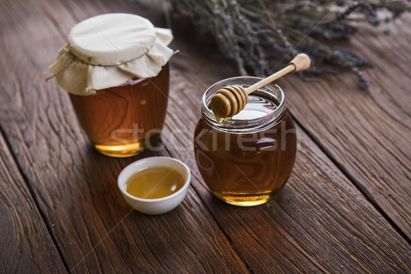 Fresh honey on wooden table Stock photo © JanPietruszka